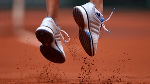 The shoes of Alize Lim of France as she serves during her match against Serena Williams on day one of the French Open