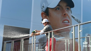 Great end to the week: Rory McIlroy sprays champagne following his victory in the BMW PGA Championship at Wentworth