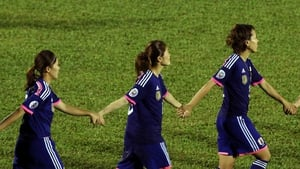 Japan celebrates by joining hands after they defeated Australia 1-0 during the AFC Women's Asian Cup Final