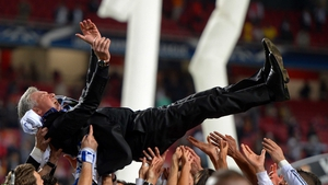 Head Coach, Carlo Ancelotti of Real Madrid is lifted in celebration by his players during the UEFA Champions League Final