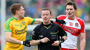 Derry's James Kielt reacts after receiving a black card from referee Joe McQuillan