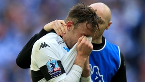 Derby County's Richard Keogh is consoled by team-mate Conor Sammon after the final whistle of the Championship play-off