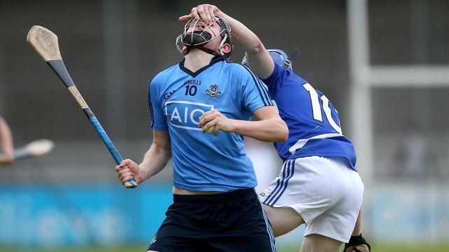 Dublin's Paul Winters has his helmet grabbed by Joe Campion of Laois