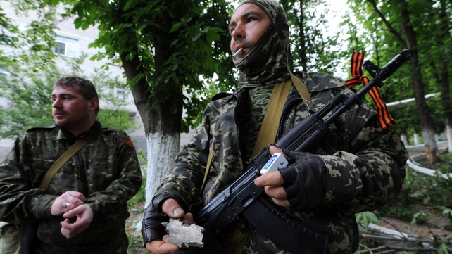 Pro-Russian militants stand guard in Semyonovka village, not far from Slaviansk