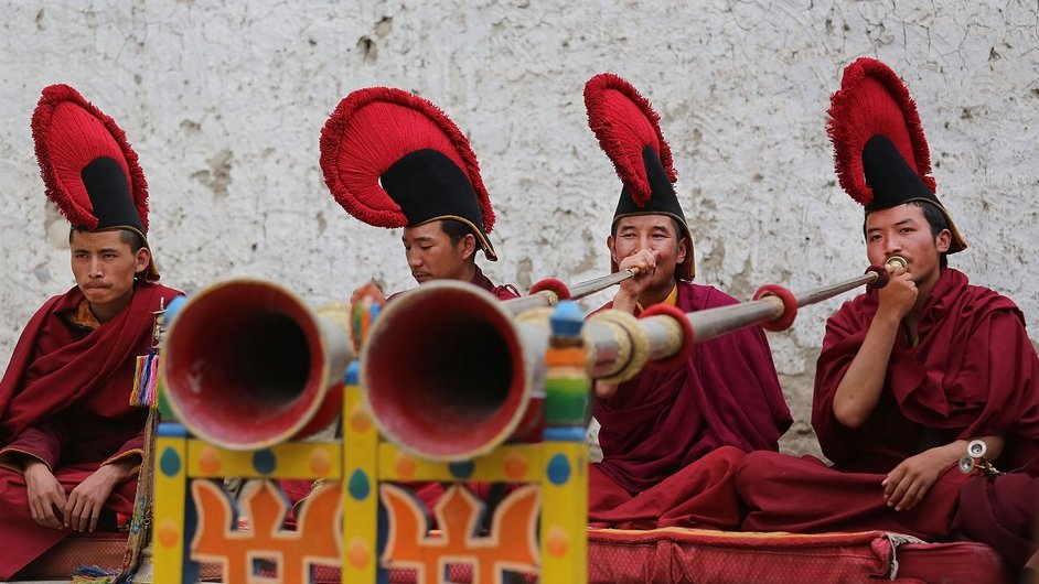 Monks play dungchen, or Tibetan horns, on the final day of ceremonies during the Tenchi Festival in Lo Manthang, Nepal