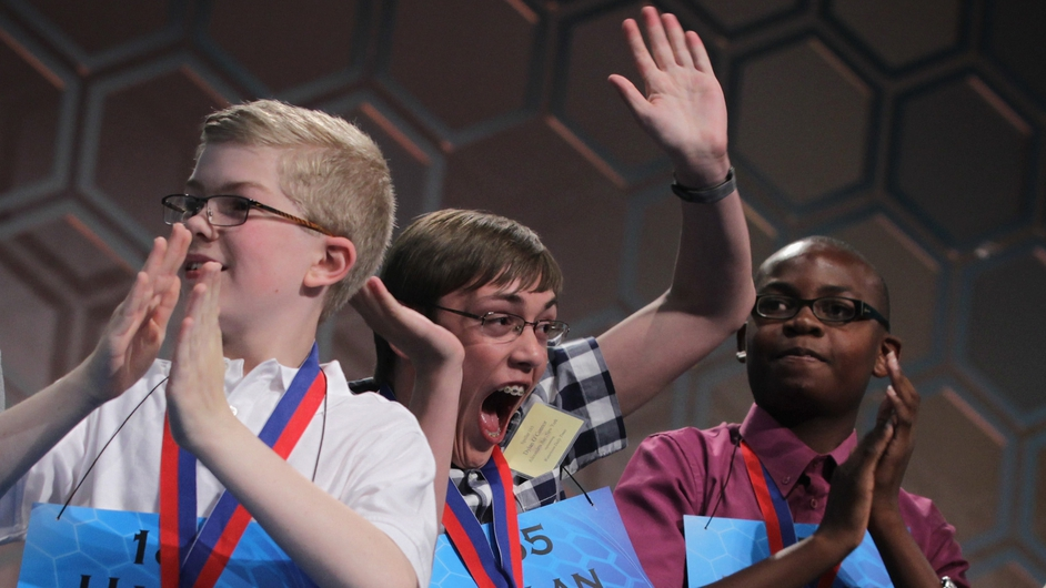 Harry Harman, Dylan O'Connor and Tajaun Gibbison celebrate after advancing to the semi-finals of the 2014 Scripps National Spelling Bee competition in Maryland, US