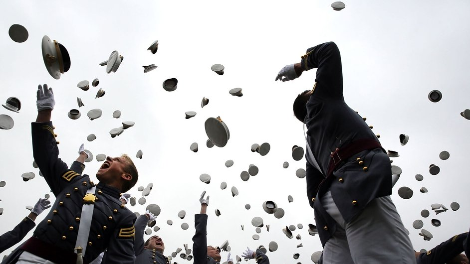 Cadets throw their hats in the air at the conclusion of the graduation ceremony at the U.S. Military Academy, New York
