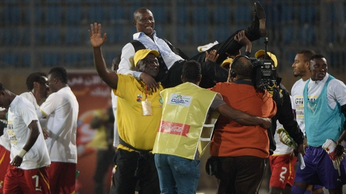 Ghana coach Kwesi Appiah celebrates with his team after beating Egypt to qualify for the 2014 World Cup