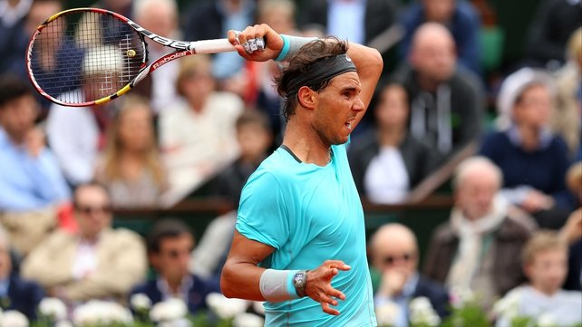Rafael Nadal unleashes his trademark buggy-whip forehand against  Dominic Thiem