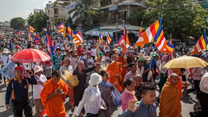 Demonstrators march near the Phnom Penh Municipal Court, Cambodia