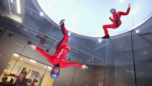 Flying instructors demonstrate wind tunnel flying at the iFly indoor skydiving facility in Rosemont, Illinois, US