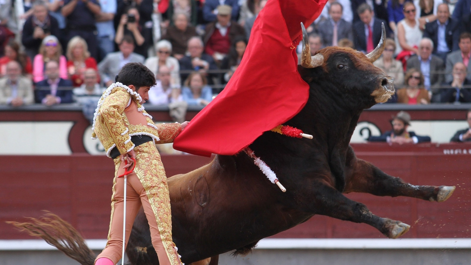 Spanish matador Alejandro Talavante performs a pass on a bull during the San Isidro Feria bullfight at the Las Ventas bullring in Madrid, Spain
