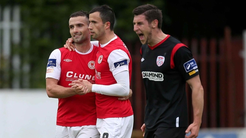 Chris Fagan and Keith Fahey celebrate while Derry suffered at Richmond Park
