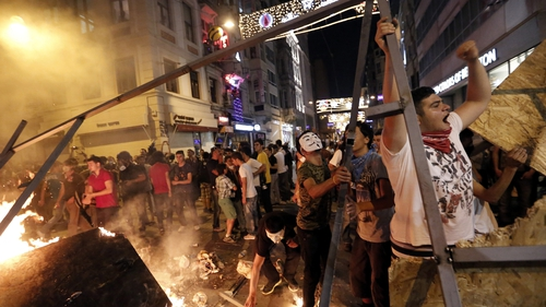 Turkish protesters set a barricade alight during an anti-government protest at Taksim Square last year