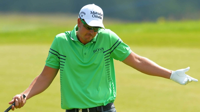 Henrik Stenson reacts after holing out for an eagle at the seventh