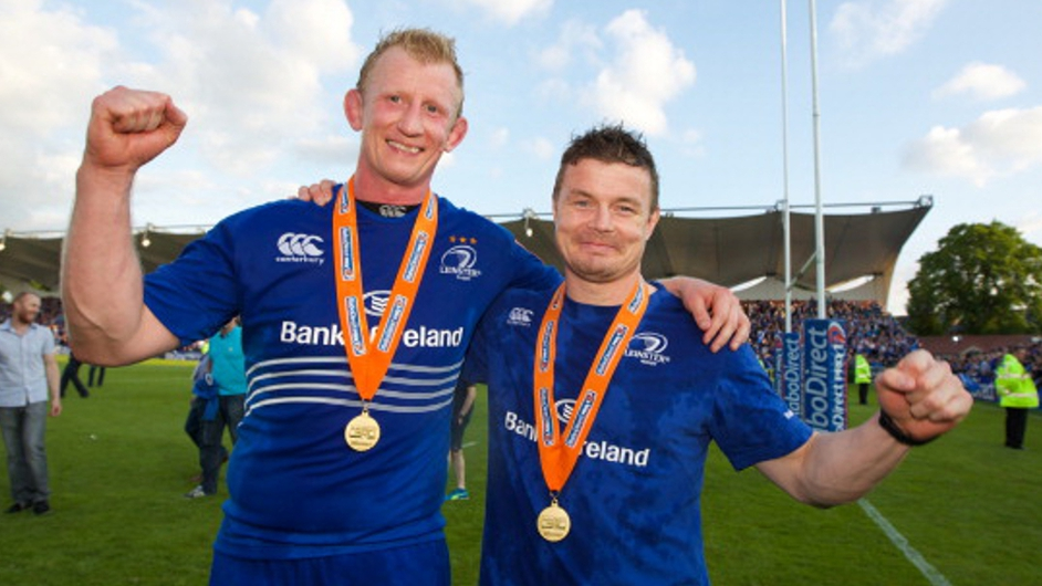 Leo Cullen and Brian O'Driscoll of Leinster, in their last ever rugby match celebrate after winning the Pro 12 trophy after victory against Glasgow