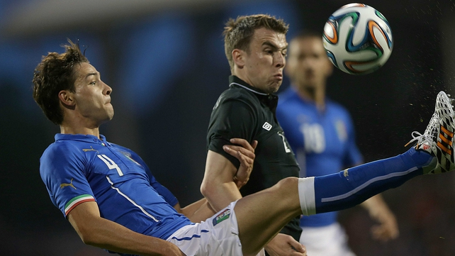 Italy's Mattia De Sciglio with Seamus Coleman battle for possesson at Craven Cottage