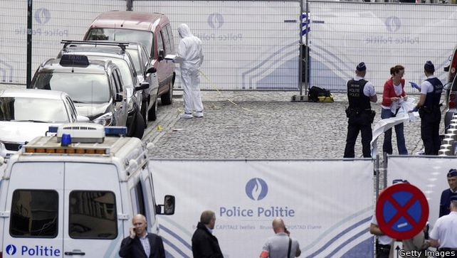 Police forensic experts search for evidence at the scene of shooting incident near the Jewish Museum in Brussels