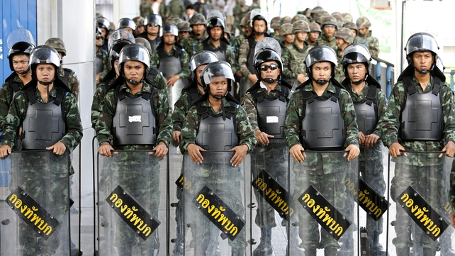 Thai soldiers prevent an anti-coup protest rally at a shopping district in Bangkok