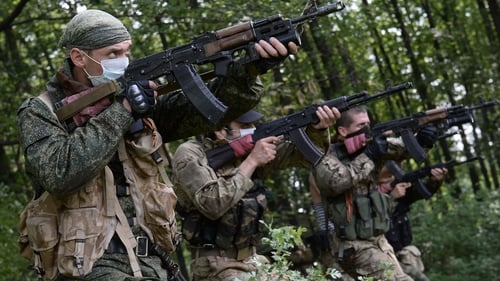 Pro-Russian militants participate in a military exercise at their training base near Donetsk