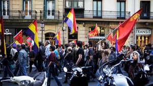 People attend a demonstration in San Sebastian, Spain after King Juan Carlos abdicated the Spanish throne