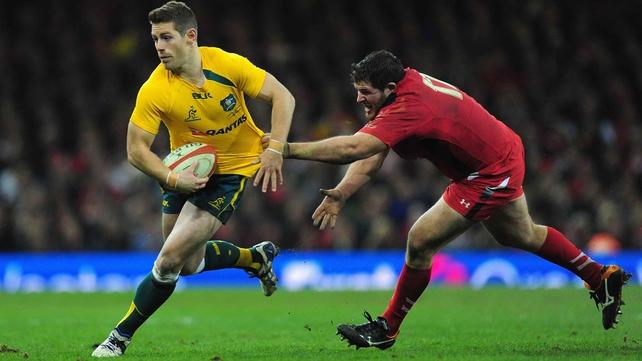 Wallabies flyhalf Bernard Foley evades a tackle