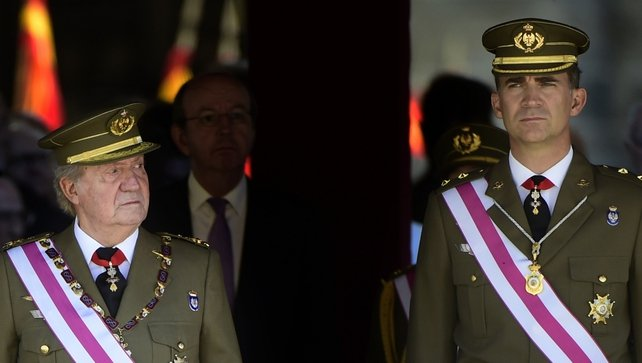 King Juan Carlos and Prince Felipe attending a military ceremony in El Escorial