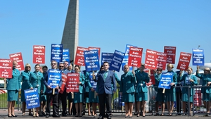 Cabin crew have been docked one day's pay for taking part in Friday's strike