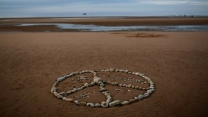 A peace sign made of beach stones is shown on Omaha Beach in Vierville, France ahead of the 70th anniversary of the D-Day landings