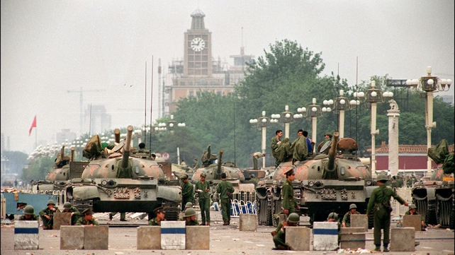 The People's Liberation Army (PLA) tanks guard a strategic Chang'an Avenue leading to Tiananmen Square