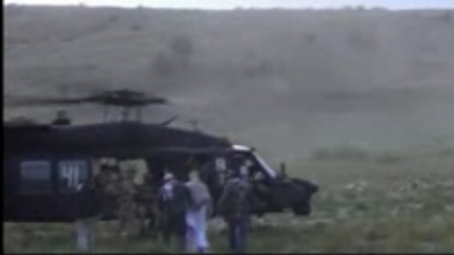 The video shows Sgt Bergdahl being taken to a Blackhawk helicopter