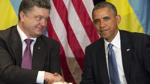 US President Barack Obama and President-elect Petro Poroshenko of Ukraine shake hands