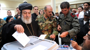 A Syrian Patriarch casts his vote in the country's presidential elections at a polling station in Jdaydet Yabous at the Syrian border
