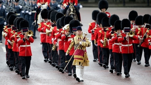 A guard of honour marches past Buckingham Palace, London, on the day Queen Elizabeth addresses UK Members of Parliament