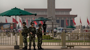 Chinese paramilitary soldiers stand guard outside Tiananmen Square