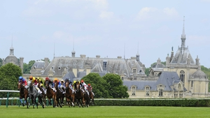 The Chateau de Chantilly looms large in the background at the pretty French racecourse