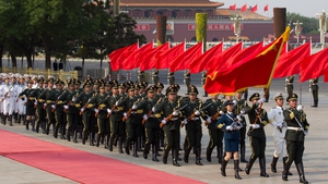 Chinese People's Liberation Army (PLA) honour guards march after a ceremony at the Great Hall of the People, beside Tiananmen Square in Beijing