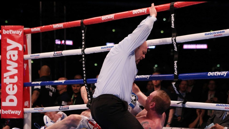 George Groves is counted out by the referee after being knocked down by Carl Froch during the IBF and WBA World Super Middleweight Title fight at Wembley