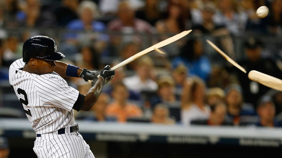 Alfonso Soriano of the New York Yankees breaks his bat fouling the ball off in the sixth inning against the Seattle Mariners at Yankee Stadium