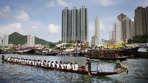 Racers compete in the Dragon Boat Festival in Aberdeen Harbour in Hong Kong on Monday