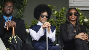 US singer Prince attends the French Open fourth round match between Spain's Rafael Nadal and Serbia's Dusan Lajovic on Court Philippe Chatrier at Roland Garros court