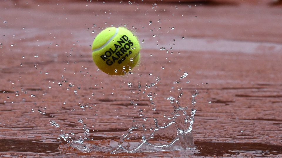 A ball rebounds off the tarpaulin covering Court Philippe Chatrier as the rains falls at the French Open in Paris