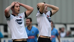 Dundalk's Kurtis Byrne and Brian Gartland react after a missed goal opportunity