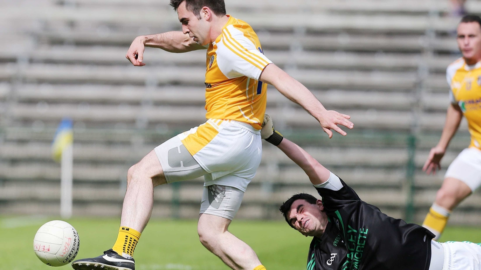 Antrim's Kevin Niblock gets past Fermanagh goalkeeper Chris Snow to score a goal in their Ulster SFC clash