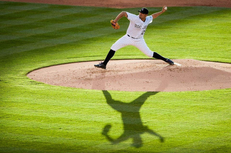 Jorge De La Rosa of the Colorado Rockies delivers a pitch against the Arizona Diamondbacks at Coors Field