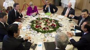 US President Barack Obama (C) sits alongside other G7 leaders during talks in Brussels