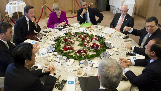 US President Barack Obama (C) sits alongside other G7 leaders during talks in Brussels