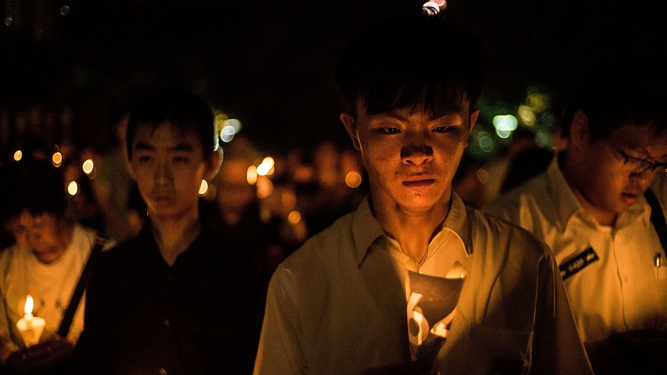 People take part in a candlelight vigil in Hong Kong, on the 25th anniversary of the Tiananmen Square protests