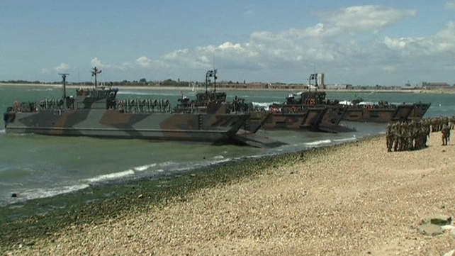 The UK Royal Navy re-enact the D-Day beach assault at Portsmouth commemorative events