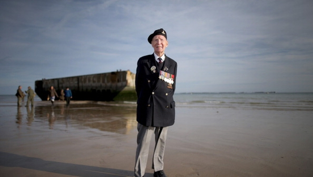D-Day veteran Bill Price, 99, on Gold Beach after the last ever flag raising ceremony by the Surrey Normandy Veterans Association